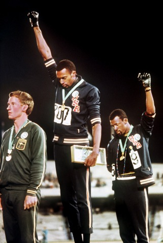 Image #: 13530908 American athletes Tommie Smith (middle, gold medal) and John Carlos (right, bronze medal) at the Award Ceremony for the 200m race at the 1968 Olympic Games in Mexico City, October 16, 1968. The Olympics Black Power salute was a notable black power protest and one of the most overtly political statements in the history of the modern Olympic Games. DPA/LANDOV